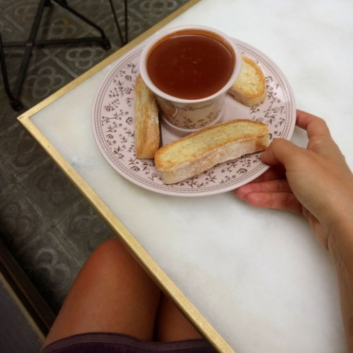The hot chocolate is served with slightly toasted fresh bread.