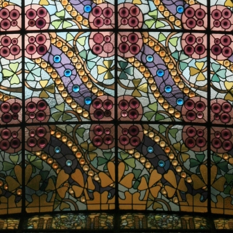The interior staircase of Casa Amatller has a generous stained glass ceiling above.