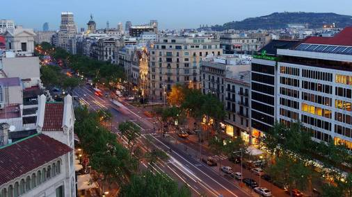 Until 1827, Passeig de Gràcia was named Camí de Jesús and joined the city of Barcelona with the neighboring town of Gràcia. With the demolition of the walls in 1854 and the start of the Eixample five years later, following the design by Ildefons Cerdà, the Passeig de Gràcia, became hugely important. Initially single family homes with gardens were built there, and coffee shops, theatres, restaurants and dance halls sprang up, making it the preferred leisure area for the bourgeoisie. Later on, after the 1888 World Fair was held in the 'Ciudad Condal' (as Barcelona is sometimes called), these homes were replaced by four-storey buildings with shops on the ground floors. Slowly but surely, the bourgeoisie began to move into this street, and competed to employ the most famous architects to build or remodel the buildings that contained their flats, which were usually on the lower floors. The ground floors of the new buildings housed pharmacies, cinemas, restaurants, stores and grocer's shops. (source). That is why we can now admire examples of the Modernist style that dominated the buildings along Passeig de Gràcia at the time; these buildings were designed by Gaudí, Domenech i Montaner, Puig i Cadafalch, Josep Vilaseca i Casanovas and many other architects from the period.