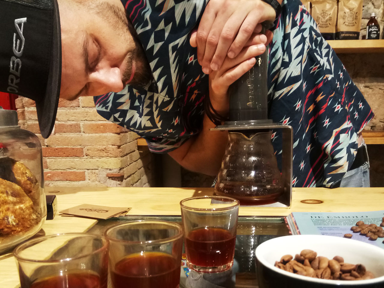 Aeropress: the coffee is literally pushed into the glass vase, by pressing constantly.