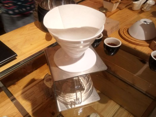The V60 has a cone shape that adds depth to the coffee layer, and several spiral ribs, inside the cone for maximum coffee expansion. The paper filter is placed inside the ceramic cone, which has a hole for the coffee to pour into the vase below.