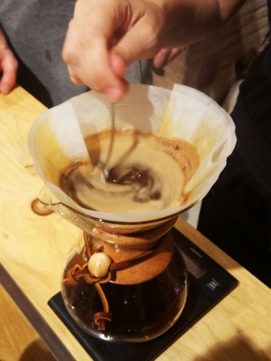 The most visually distinctive feature of the Chemex is the heatproof wooden collar around the neck, allowing it to be handled and poured when full of hot water. This is turned, then split in two to allow it to fit around the glass neck. The two pieces are held loosely in place by a tied leather thong. The pieces are not tied tightly and can still move slightly, retained by the shape of the conical glass. For a design piece that became popular post-war at a time of Modernism and precision manufacture, this juxtaposition of natural wood and the organic nature of a hand-tied knot with the laboratory nature of glassware was a distinctive feature of its appearance.