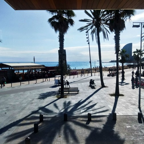 The view captures the entire beach of Barceloneta, up to Hotel Vella (arch. Ricadro Bofill) in the background.