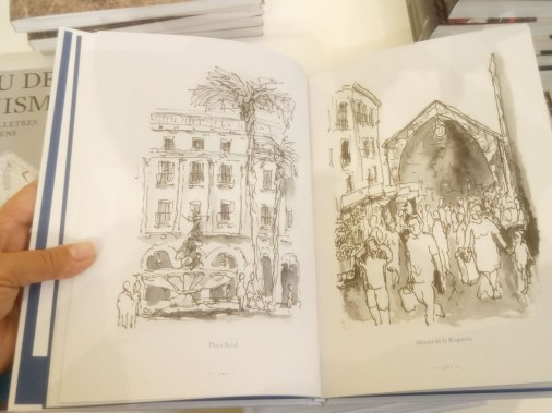 Barcelona La Ciutat Dibuixada is a collection of drawings by Catalan artist Gerard Rosés, depicting the main sites of the city. Here, there is Plaça Reial, on left, and La Boqueria Market, on right page.
