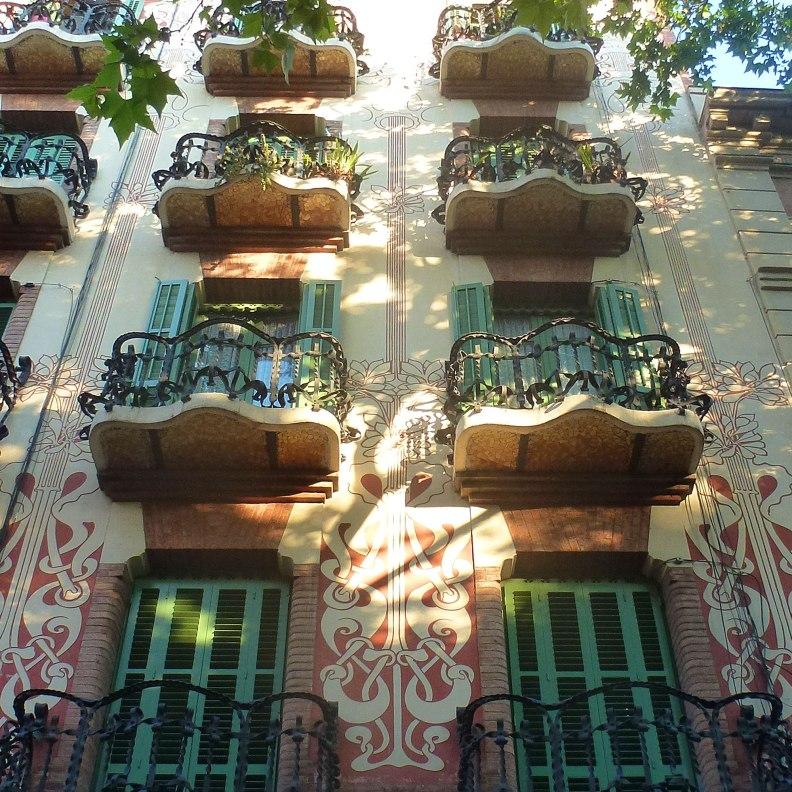 Casa Rubinat balconies wrought iron trencadis floral sgraffito