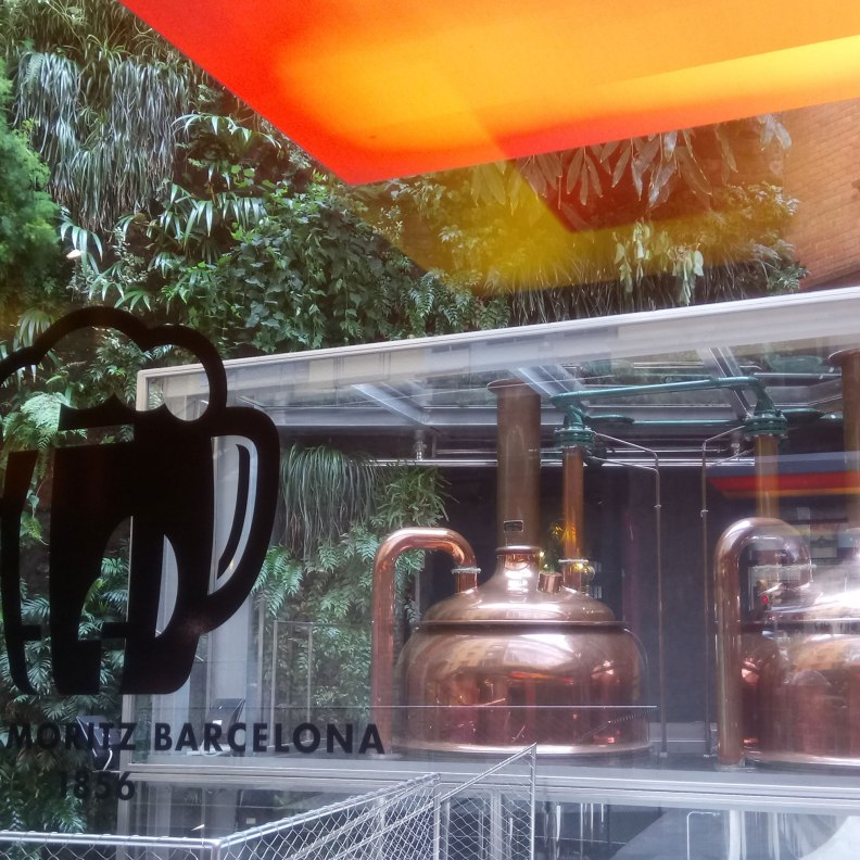 Jean Nouvel Fabrica Moritz vintage beer tanks near green vertical garden by Patrick Blanc