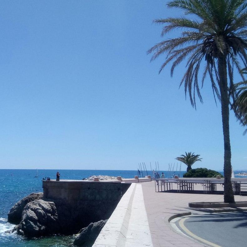 Sant Pol de Mar sea promenade palm trees